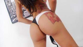Tattooed shemale Brenda Lohan jerks her big dick off
