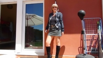Sexy granny in boots and nylons