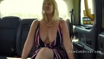 huge tits mature lesbian licking in cab