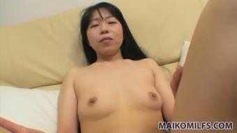 Yasuko Haraguchi thinks of pleasing her pussy with small dildo