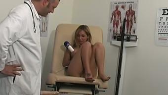 Lewd patient Roxy Jezel looks happy to masturbate in front of her gynecologist