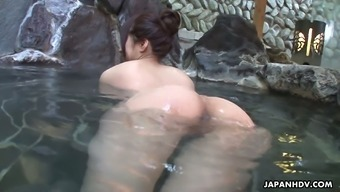 Spoiled Asian chick Rin Hitomi hooks up with one stranger in a public bath