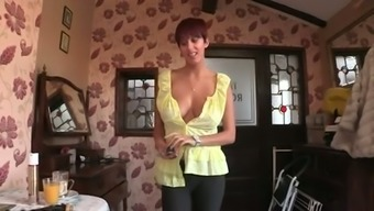 Red-haired seductress with big natural tits knows how to seduce a man