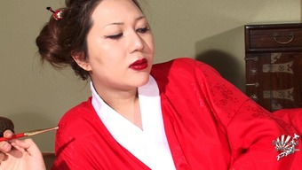 Asian shemale in red clothes plays with her own small pecker