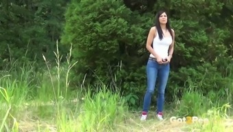 Sassy brunette gal in jeans Rebecca  pees in the forest