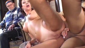 Sexy cougar with short dark hair enjoying a hardcore anal fuck