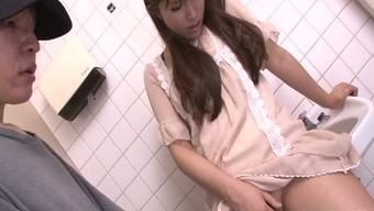 Enchanting Japanese girl gives handjob in a toilet