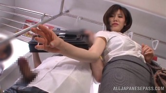 Beautiful Japanese Girl Serves A Handjob In A Bus Full Of People