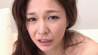 Pretty Japanese milf with sexy small tits rides a dick