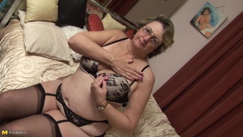 Kinky bespectacled granny has some fun with her favorite sex toy