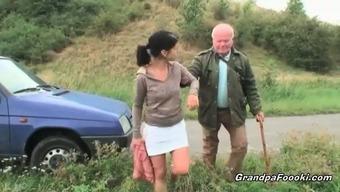 Cute babe seduces grandpa on the road