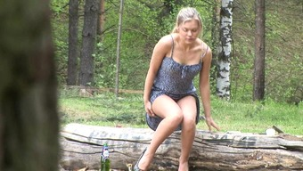 Blonde in short dress pisses outdoors