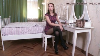 Eye catching femdom diva showing off her hot ass while receiving superb pussy licking in BDSM porn
