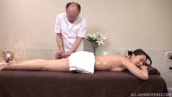 Bald Japanese guy gives the chick both the massage and the bonking