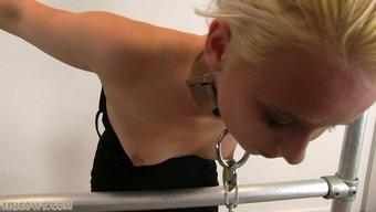 Severe punishment for blonde sex slave on milking machine