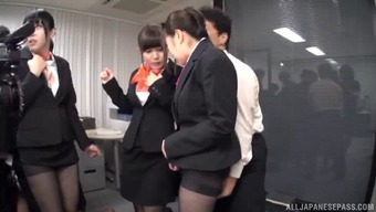 Suit-wearing Japanese chicks having a huge penetration orgy