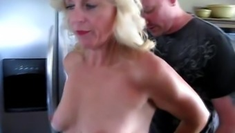 Mature blonde gets fucked silly on the kitchen counter