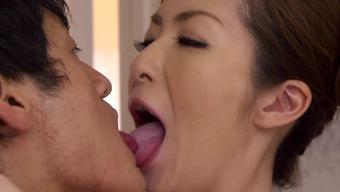 Lovely Japanese milf enjoys getting her pussy fingered