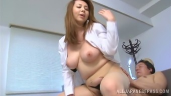 Fleshy cougar with big tits receiving fancy rim job before getting hammered hardcore in the office