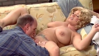 Short haired frizzy blonde MILF with huge saggy tits sucks fat cock