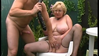 Dutch granny visits the backyard in order to get totally naughty there