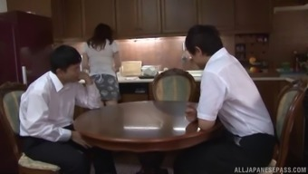 Brown-haired beauty from Japan moans as the guy screws her beaver