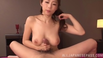 Kinky Japanese babe with natural tits blind folds her man before milking his cock