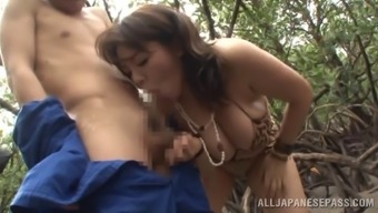 Sexy Asian babe gives a hardcore blowjob in Femdom outdoor action
