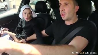 Slutty dark haired nun gives steamy deep throat to her friend in car