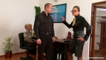 Women in blouses use a male sub