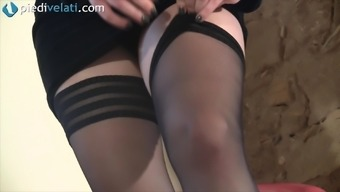 She pulls her nylons up and slips into her high heels