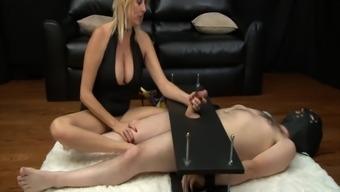 Mean MILF gives brutal femdom handjob to cock in bondage