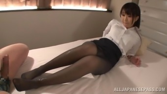 Foot fetish babe in nylon pantyhose performing her lovely teases