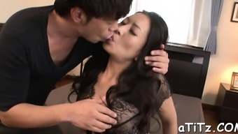 Pretty oriental playgirl gives salacious and wild titty fuck