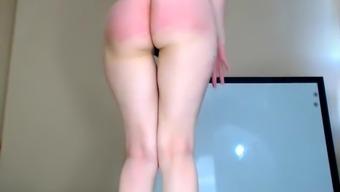 Big booty blonde spanks herself