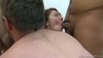 Busty curly haired plumper Kiki Daire and several bisexual geeks performs dirty group sex