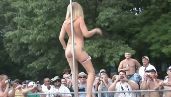 Horny blonde in high heels dancing at the stripper pole outside