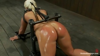 Oiled up bondage and as spanking for Kati Snow