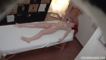 Redhead Czech slut gets pounded on the massage table