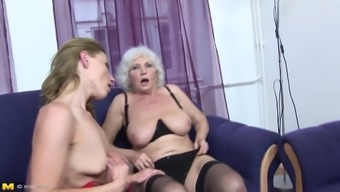 Pretty milf and a dirty granny share a rock hard cock