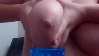 Milking her own big tits on webcam