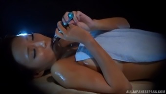 Cute Asian girl gets her cunt massaged with a stiff shaft