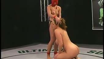 Hot chick in red mask pounds Christina Carter in a ring