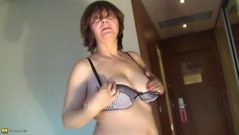 Elvira passionately pleasuring her pussy using toy