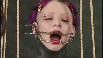 Inez gets pulled by the nipples and tongue in BDSM video