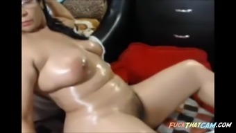 Horny Latina brunette shows off that buxom body
