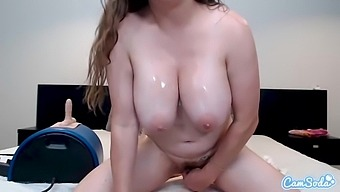 Elay Smith with big oiled up boobs rides sybian and toys her pussy with dildo