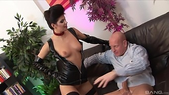 Lucy Love wears black latex and fucks with her handsome friend