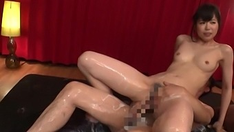 Asian milf oils her pussy to fuck with the young guy better