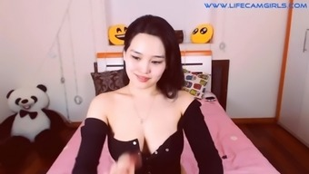 Gorgeous korean beauty brunette with big tits is chatting in online sex chat